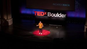 Ricardo Baca, CEO of Grasslands speaking on the Ted Talk Boulder stage